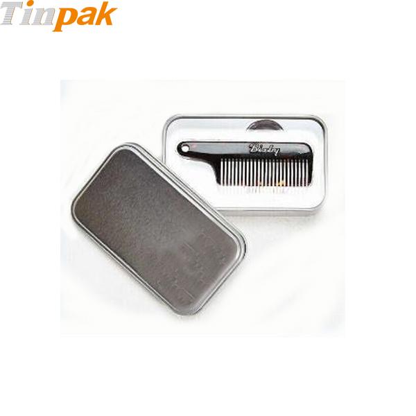 Primitive comb tin box